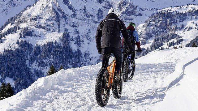 Mountain bikes in the snowy mountains.
