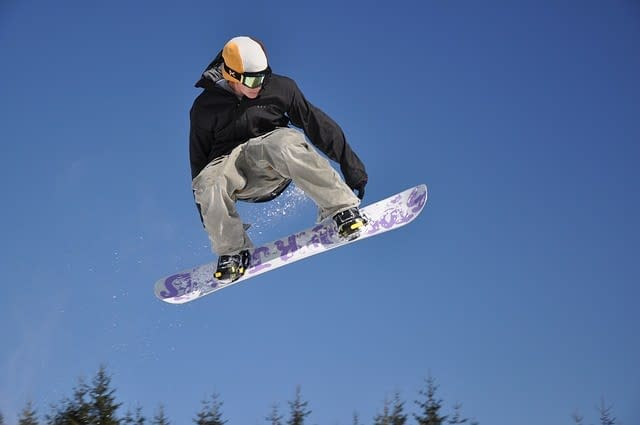 Snowboarder in mid air.