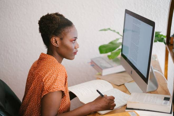 Young black lady studying online
