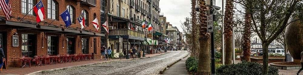 Savannah, Georgia. Waterside street lined by hotels and cobble stones.