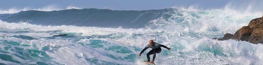 Surfer in high seas of Hawaii coast